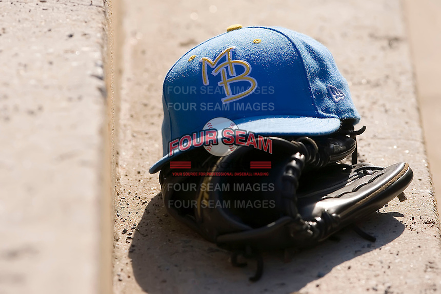 A Myrtle Beach Pelicans hat sits on top of a glove in the visitors dugout at Harry Grove Stadium in Frederick, MD, Monday July 14, 2008. (Photo by Brian Westerholt / Four Seam Images)