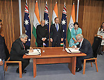 AUSTRALIA, Canberra : Indian Prime Minister Narendra Modi (CL) and Australian Prime Minister Tony Abbott (CR) watch as a memorandum of understanding in the field of tourism is signed by the Indian Minister of External Affairs Anil Wadhwa (L) and the Australian Minister for Trade and Investment Andrew Robb (R) at Parliament House, Canberra on November 18, 2014. AFP PHOTO / MARK GRAHAM