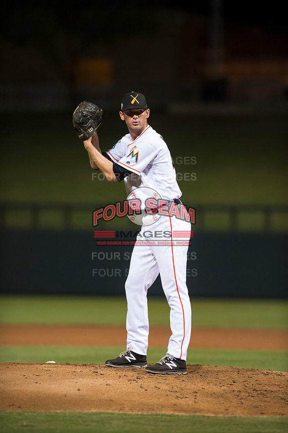 Salt River Rafters relief pitcher Kyle Keller (40), of the Miami Marlins organization, gets ready to deliver a pitch during an Arizona Fall League game against the Scottsdale Scorpions at Salt River Fields at Talking Stick on October 11, 2018 in Scottsdale, Arizona. Salt River defeated Scottsdale 7-6. (Zachary Lucy/Four Seam Images)