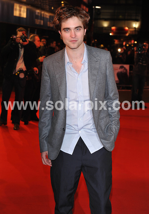 **ALL ROUND PICTURES FROM SOLARPIX.COM**.**WORLDWIDE SYNDICATION RIGHTS**.Red carpet arrivals at the UK Premiere of Remember Me.  Held at The Odeon, Leicester Square, London, ..This pic:  Robert Pattinson..JOB REF: 10913      SSD     DATE: 17.03.2010.**MUST CREDIT SOLARPIX.COM OR DOUBLE FEE WILL BE CHARGED**.**MUST NOTIFY SOLARPIX OF ONLINE USAGE**.**CALL US ON: +34 952 811 768 or LOW RATE FROM UK 0844 617 7637**