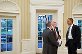 United States President Barack Obama talks with Richard Reed, Deputy Assistant to the President for Homeland Security, left, and John Brennan, Assistant to the President for Homeland Security and Counterterrorism, about  the ongoing response to Hurricane Sandy, in the Oval Office, October 29 2012. .Mandatory Credit: Pete Souza - White House via CNP