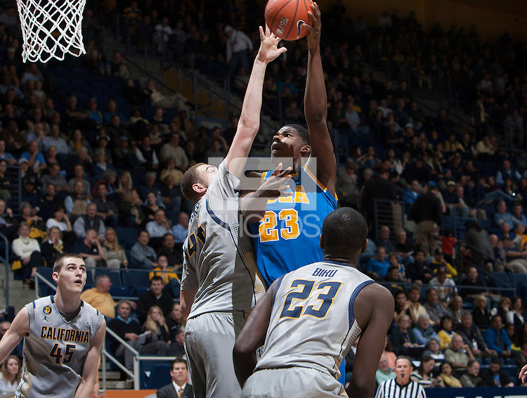 Kameron Rooks of California tries to block UCLA's Tony Parker's ball during the game at Haas Pavilion in Berkeley, California on February 19th, 2014.  UCLA defeated California, 86-66.
