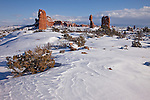 Snow patterns in the foreground with Balanced Rock in Arches National Park near Moab, Utah, USA after a snow storm.