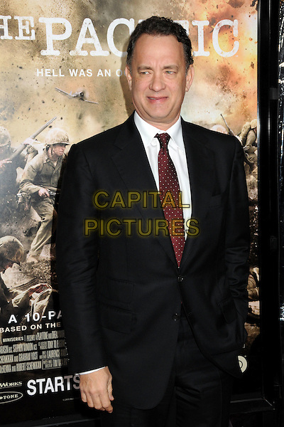 "TOM HANKS .HBO's ""The Pacific"" Mini-Series Premiere held at Grauman's Chinese Theatre, Hollywood, California, USA..February 24th, 2010.half length suit jacket red tie black white .CAP/ADM/BP.©Byron Purvis/AdMedia/Capital Pictures."
