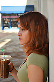 Stock photo of a woman drinking coffee