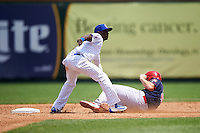 South Bend Cubs shortstop Andruw Monasterio (6) tags out R.J. Dennard (35) sliding into second during the first game of a doubleheader against the Peoria Chiefs on July 25, 2016 at Four Winds Field in South Bend, Indiana.  South Bend defeated Peoria 9-8.  (Mike Janes/Four Seam Images)