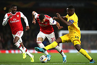 Paul-Jose Mpoku of Standard Liege tackles Arsenal's Gabriel Martinelli during Arsenal vs Standard Liege, UEFA Europa League Football at the Emirates Stadium on 3rd October 2019