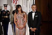 President Barack Obama and First Lady Michelle Obama wait for Prime Minister of Italy Matteo Renzi and Mrs. Agnese Landini to arrive at the North Portico  of the White House on October 18, 2016 in Washington, DC. <br /> Credit: Olivier Douliery / Pool via CNP