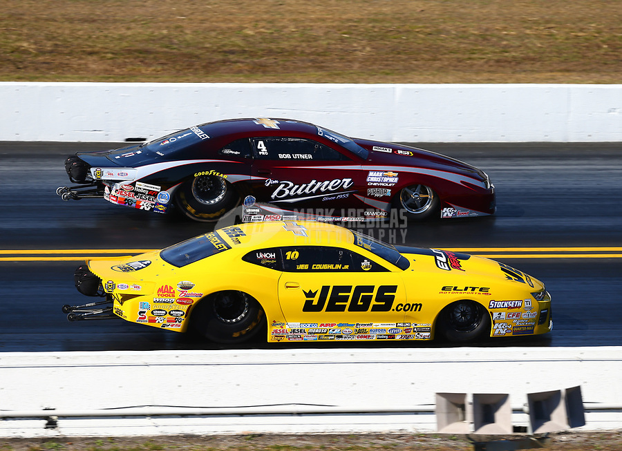 Mar 18, 2017; Gainesville , FL, USA; NHRA pro stock driver Jeg Coughlin Jr (near) races alongside Bo Butner during qualifying for the Gatornationals at Gainesville Raceway. Mandatory Credit: Mark J. Rebilas-USA TODAY Sports