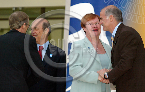 PORTO CARRAS - GREECE - 19 JUNE 2003 --The Thessaloniki EU-Summit.--The Greek Prime Minister Constatinos SIMITIS (2nd.L) and the Greek Foreign Minister George A. PAPANDREOU (R) greeting the Finnish President Tarja HALONEN, Antti KALLIOM?KI the Finnish Finance Minister acting as Prime Minister.-- PHOTO: JUHA ROININEN / EUP-IMAGES