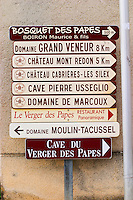 Signs pointing to wine producers: Bosquets des Papes Boiron Maurice, Domaine Grand Veneur, Mont Redon, Cabrieres Les Silex, Pierre Usseglio, de Marcoux, Verger des Papes, Moulin Tacussel Chateauneuf-du-Pape Châteauneuf, Vaucluse, Provence, France, Europe Chateauneuf-du-Pape Châteauneuf, Vaucluse, Provence, France, Europe