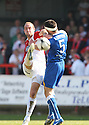 Robbie Matthews of Kidderminster tussles with Jon Ashton of Stevenage Borough during the Blue Square Premier match between Kidderminster Harriers and Stevenage Borough at the Aggborough Stadium, Kidderminster on Saturday 17th April, 2010..© Kevin Coleman 2010