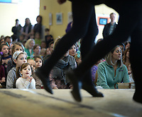 NWA Democrat-Gazette/ANDY SHUPE<br /> Audience members watch Saturday, March 16, 2019, during a performance by dancers from Rince Arkansas Academy of Irish Dance in Fayetteville at the Fayetteville Public Library. Dancers of all ages performed ahead of St. Patrick's Day, which is today.