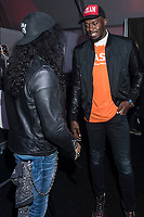 LAS VEGAS, NV - JANUARY 9: Slash and Usain Bolt at the Gibson Tent at CES 2018 in Las Vegas, Nevada on January 9, 2018. <br /> CAP/MPI/DAM<br /> &copy;DAM/MPI/Capital Pictures