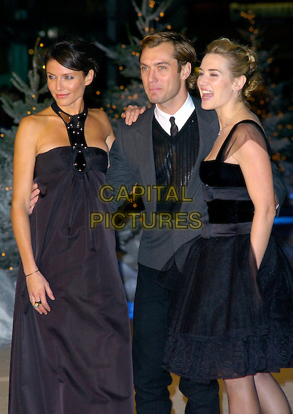 "CAMERON DIAZ, JUDE LAW & KATE WINSLET.At the UK Film Premiere of ""The Holiday"", Odeon Leicester Square, London, UK..December 5th 2006.half length black puffy puffball skirt dress halterneck grey gray suit jacket arms around waist.CAP/CAN.©Can Nguyen/Capital Pictures"