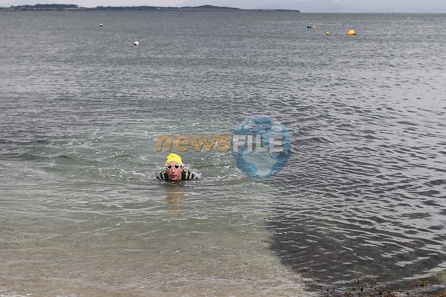 "2nd Place Oran Kane at the Clogherhead ""Round the Head Swim""....(Photo credit should read Jenny Matthews/NEWSFILE)..."