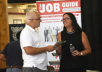 NWA Democrat-Gazette/FLIP PUTTHOFF <br />HELP WANTED, HELP FOUND<br />Mike Parker (left) talks Wednesday Oct. 3 2018 with Sunny Martinez, publisher of  The Job Guide at the fall job fair at Frisco Station Mall in Rogers. Rogers-Lowell Area Chamber of Commerce hosts the fair each autumn and spring. About 45 companies talked with prospective employees Wednesday at the fair.