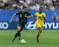 GRENOBLE, FRANCE - JUNE 18: Emily Gielnik #15 of the Australian National Team dribbles down the wing during a game between Jamaica and Australia at Stade des Alpes on June 18, 2019 in Grenoble, France.