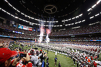 The Ohio State Buckeyes rush onto the field before the Allstate Sugar Bowl and College Football Playoff Semifinal at Mercedes-Benz Superdome in New Orleans, Thursday night, January 1, 2015. (The Columbus Dispatch / Eamon Queeney)