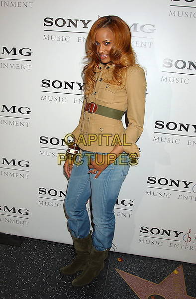 CIARA.Sony BMG Grammy Party 2005 held at the Roosevelt Hotel, Los Angeles, California.February 13th, 2005.Photo Credit: Laura Farr/AdMedia.full length jeans tucked into boots denim beige khaki top green belt.www.capitalpictures.com.sales@capitalpictures.com.© Capital Pictures.