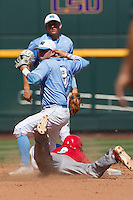 North Carolina second baseman Mike Zolk (3) turns a double play during Game 3 of the 2013 Men's College World Series against the North Carolina State Wolfpack at TD Ameritrade Park on June 16, 2013 in Omaha, Nebraska. The Wolfpack defeated the Tar Heels 8-1. (Andrew Woolley/Four Seam Images)