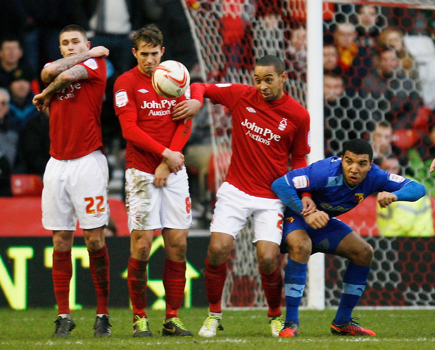 L to R Nottingham Forest's Henri Lansbury, Chris Cohen and Dexter Blackstock face up to a Watford free kick..Football - npower Football League Championship - Nottingham Forest v Watford   - Saturday 26th january 2013 - The City Ground - Nottingham..