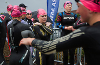 10 AUG 2014 - LIVERPOOL, GBR - Competitors prepare for the start of the elite women's wave at the Tri Liverpool triathlon in Kings Dock in Liverpool, Great Britain (PHOTO COPYRIGHT © 2014 NIGEL FARROW, ALL RIGHTS RESERVED)