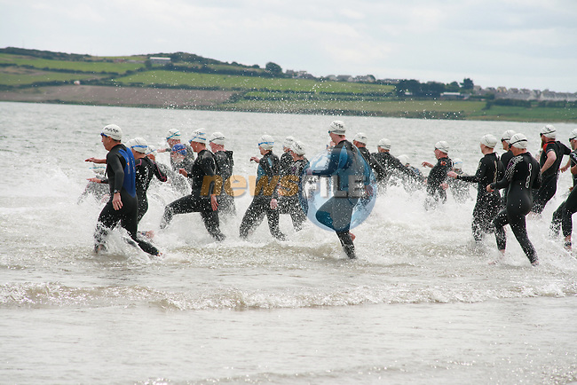Taking the Plunge at the Pulse Triathlon in Clogherhead...Photo NEWSFILE/Jenny Matthews.(Photo credit should read Jenny Matthews/NEWSFILE)....This Picture has been sent you under the condtions enclosed by:.Newsfile Ltd..The Studio,.Millmount Abbey,.Drogheda,.Co Meath..Ireland..Tel: +353(0)41-9871240.Fax: +353(0)41-9871260.GSM: +353(0)86-2500958.email: pictures@newsfile.ie.www.newsfile.ie.FTP: 193.120.102.198.