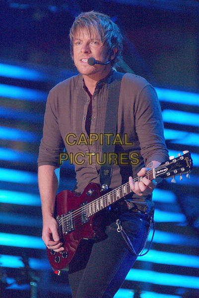 JOE DON ROONEY - RASCAL FLATTS.2007 CMA Music Festival held at LP Field, Nashville, Tennessee, USA..June 9th, 2007.half length stage concert live music gig performance guitar brown shirt.CAP/ADM/GS.©George Shepherd/AdMedia/Capital Pictures
