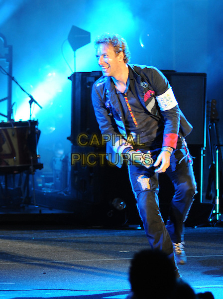 COLDPLAY - Chris Martin.Coldplay performs live during their Viva la Vida Tour at Verizon Wireless Ampitheatre in Irvine, California, USA. .July 19th, 2009.*For Editorial Use Only* .stage concert gig performance full length black jacket trousers                            .CAP/DVS.©Debbie VanStory/Capital Pictures.