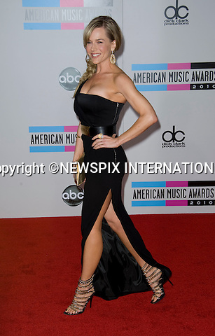 "JULIE BENZ.FEET FASHION_from tattoos, fish-net tights to animal print heels the stars made a statement..American Music Awards 2010,Nokia Theatre, Los Angeles_21/10/2010.Mandatory Photo Credit: ©Dias/Newspix International..**ALL FEES PAYABLE TO: ""NEWSPIX INTERNATIONAL""**..PHOTO CREDIT MANDATORY!!: NEWSPIX INTERNATIONAL(Failure to credit will incur a surcharge of 100% of reproduction fees)..IMMEDIATE CONFIRMATION OF USAGE REQUIRED:.Newspix International, 31 Chinnery Hill, Bishop's Stortford, ENGLAND CM23 3PS.Tel:+441279 324672  ; Fax: +441279656877.Mobile:  0777568 1153.e-mail: info@newspixinternational.co.uk"