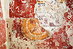 Building interior medieval circular cross symbol painted on wall of church obscured by many layers of paint architectural feature, Inglesham, Wiltshire, England,