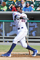 Tennessee Smokies third baseman Junior Lake #28 swings at a pitch during a game against the Tennessee Smokies at Smokies Park on August 12, 2012 in Kodak, Tennessee. The Smokies defeated the Stars 4-0. (Tony Farlow/Four Seam Images).
