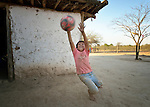 Kevin Rojas plays football at his home in Santa Victoria Este, Argentina. Rojas, 10, lives in an area of the Chaco where indigenous Wichi families, who traditionally survived as hunter-gatherers, have struggled against the systematic expropriation of their land for over a century by mestizo cattleraisers who migrated into the region from elsewhere in Argentina. In 2014, the two groups finally agreed on a division of the land which recognizes the traditional land rights of the indigenous, and which resettles many mestizo families--including that of Rojas--onto non-indigenous land. Church World Service has worked as a partner with local residents as they negotiated the landmark settlement.