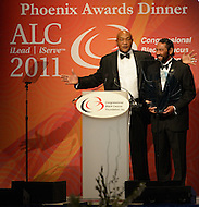 September 24, 2011  (Washington, DC)   Boxing Champion George Foreman receives The Phoenix Award from Representative Al Green (D-TX).  The Phoenix Award is given to individuals that positively impact the African-American experience.  The Phoenix Award Dinner concluded a week-long series of activities and panel discussions during the 41st Annual Legislative Conference of the Congressional Black Caucus Foundation.   (Photo by Don Baxter/Media Images International)