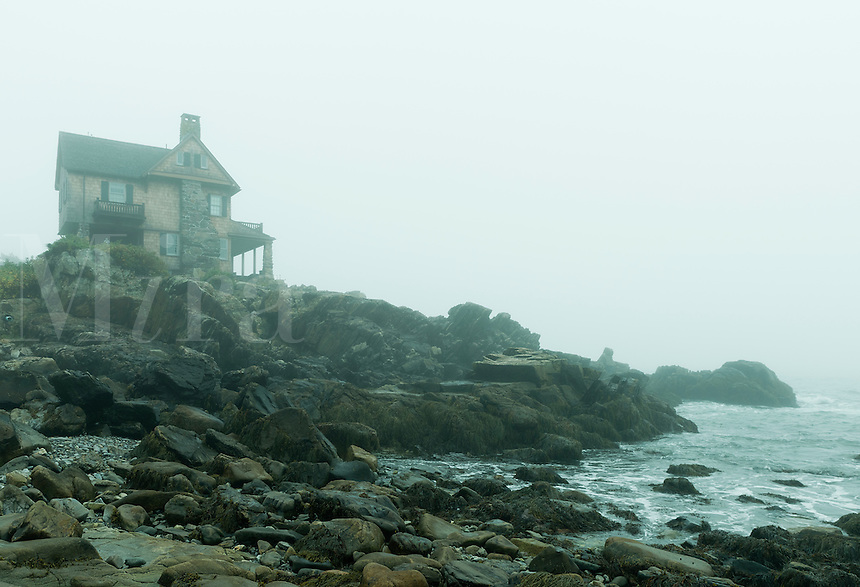 Coastal beach house overlooking a foggy sea, Kennebunkport, Maine, USA.
