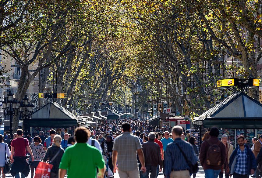 Tourists and Spaniards crowd the popular La Rambla area, Barcelona, Spain