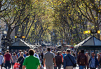 Tourists and Spaniards crowd the popular La Rambla area, Barcelona, Spain