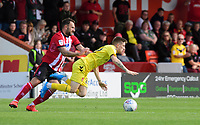 Fleetwood Town's Ashley Hunter is fouled by Lincoln City's Neal Eardley<br /> <br /> Photographer Chris Vaughan/CameraSport<br /> <br /> The EFL Sky Bet League One - Lincoln City v Fleetwood Town - Saturday 31st August 2019 - Sincil Bank - Lincoln<br /> <br /> World Copyright © 2019 CameraSport. All rights reserved. 43 Linden Ave. Countesthorpe. Leicester. England. LE8 5PG - Tel: +44 (0) 116 277 4147 - admin@camerasport.com - www.camerasport.com