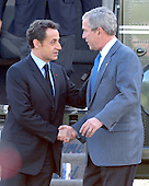Camp David, MD - October 18, 2008 --  United States President George W. Bush, right, welcomes President Nicolas Sarkozy of France, who also serves as this year's rotating President of the European Union (EU), left, to the Presidential Retreat near Thurmont, Maryland for talks on Saturday, October 18, 2008.  The two European leaders stopped at Camp David to meet with President Bush to discuss the economy on their way home from a summit in Canada to try to convince Bush to support a summit by year's end to try to reform the world financial system..Credit: Ron Sachs / Pool via CNP