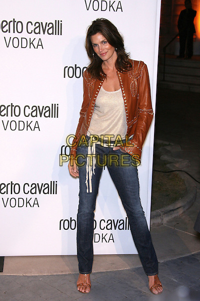 CINDY CRAWFORD.Roberto Cavalli Vodka Launch Party held at a private residence, Holmby Hills, California, USA..May 11th, 2006.Photo: Zach Lipp/AdMedia/Capital Pictures.Ref: ZL/ADM.full length brown leather jacket jeans denim.www.capitalpictures.com.sales@capitalpictures.com.© Capital Pictures.