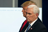 March 31, 2020 - Washington, DC, United States: United States Vice President Mike Pence and United States President Donald J. Trump participate in a news briefing by members of the Coronavirus Task Force at the White House. <br /> Credit: Chris Kleponis / Pool via CNP