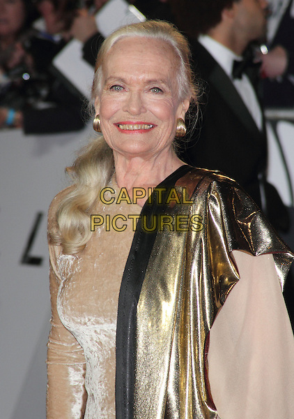 Shirley Eaton.Royal World Premiere of 'Skyfall' held at the Royal Albert Hall, London, England..October 23rd, 2012.half length gold dress nude velvet scarf.CAP/ROS.©Steve Ross/Capital Pictures.