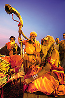 India. Uttar Pradesh state. Allahabad. Maha Kumbh Mela. The Kumbh Mela, believed to be the largest religious gathering is held every 12 years on the banks of the 'Sangam'- the confluence of the holy rivers Ganga, Yamuna and the mythical Saraswati. The old man is a sanyasi wearing saffron clothes and giving his blessing to pilgrims. In Hinduism, the sanyasis or renunciates have left behind all material attachments. They are renouncers who have chosen to live a life apart from or on the edges of society in order to focus on their own spiritual practice. A man plays the Ramsinga which is an ancient musical instrument from India. It is basically a natural trumpet consisting of four pipes of very thin metal which fit one within the other. The Maha (great) Kumbh Mela, which comes after 12 Purna Kumbh Mela, or 144 years, is always held at Allahabad. Uttar Pradesh (abbreviated U.P.) is a state located in northern India. 11.02.13 © 2013 Didier Ruef