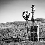 Two windmills and water tank, Bitterwater Valley in the Temblor Range &amp; San Andreas Rift Zone, San Luis Obispo County, California.<br /> <br /> Dempster and Aermotor windmills