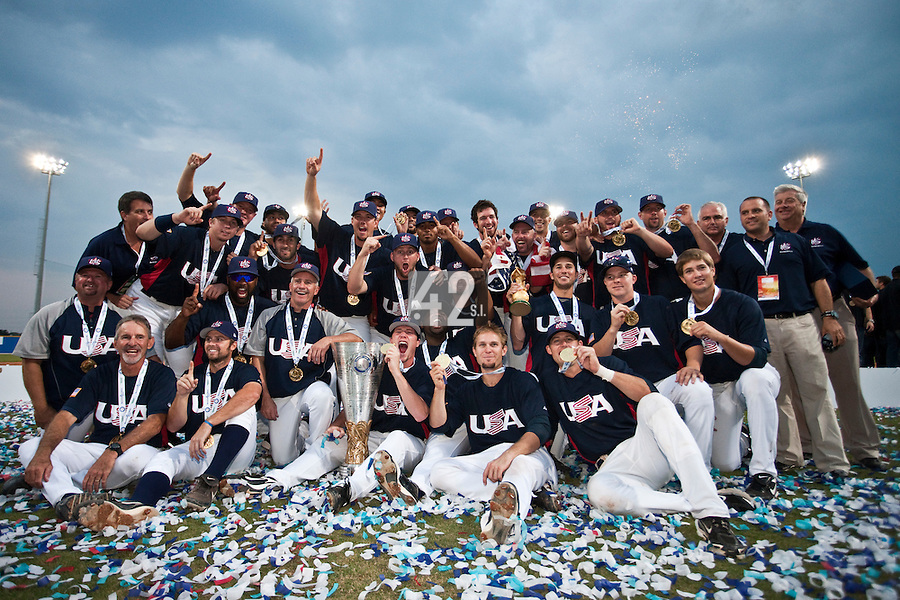 27 September 2009: Team USA members pose with the World Cup trophy as they celebrate their victory after beating Cuba 10-5 during the 2009 Baseball World Cup gold medal game, in Nettuno, Italy.