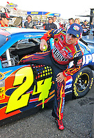 Nov. 9, 2008; Avondale, AZ, USA; NASCAR Sprint Cup Series driver Jeff Gordon climbs from his car after blowing an engine during the Checker Auto Parts 500 at Phoenix International Raceway. Mandatory Credit: Mark J. Rebilas-