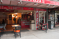 New York, NY -  2 November 2012 A Pizza Parlour on University Place powers their kitchen with an electric generator and serves customers by candlelight in the aftermath of Hurricane Sandy.