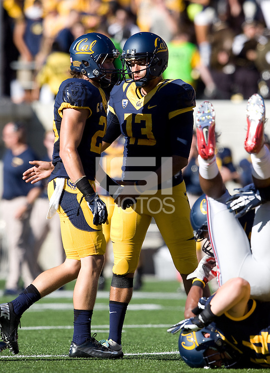 California kicker Vincenzo D'Amato celebrates with Jackson Bouza of California after scoring a field goal during the game against Ohio State at Memorial Stadium in Berkeley, California on September 14th, 2013.  Ohio State defeated California, 52-34.