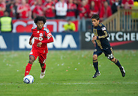 15 April 2010: Toronto FC midfielder Julian de Guzman #6 takes the ball up field as Philadelphia Union midfielder Rogers Torres #20 gives chase during a game between the Philadelphia Union and Toronto FC at BMO Field in Toronto..Toronto FC won 2-1..Photo by Nick Turchiaro/isiphotos.com........12 September 2009:Toronto FC forward Chad Barrett # 19 takes the ball up field during MLS action at BMO Field Toronto in a game between Colorado Rapids and Toronto FC. .Photo by Nick Turchiaro/isiphotos.comApril 12 2010: Chicago White Sox second baseman Gordon Beckham #15 and Chicago White Sox shortstop Omar Vizquel #11celebrate the win during the Toronto Blue Jays home opener between the Chicago White Sox and the Toronto Blue Jays at Rogers Centre in Toronto, Ontario..The White Sox won 8-7 in 11 innings.........11 April 2009:Toronto FC forward Chad Barrett # 19 takes the ball up field during MLS action at BMO Field Toronto, in a game between FC Dallas and Toronto FC. .Toronto FC won 2-1.